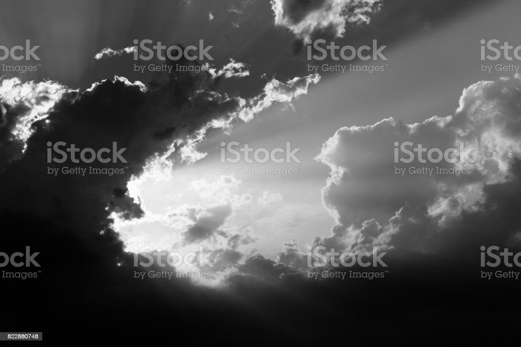 Clouds and sun rays stock photo