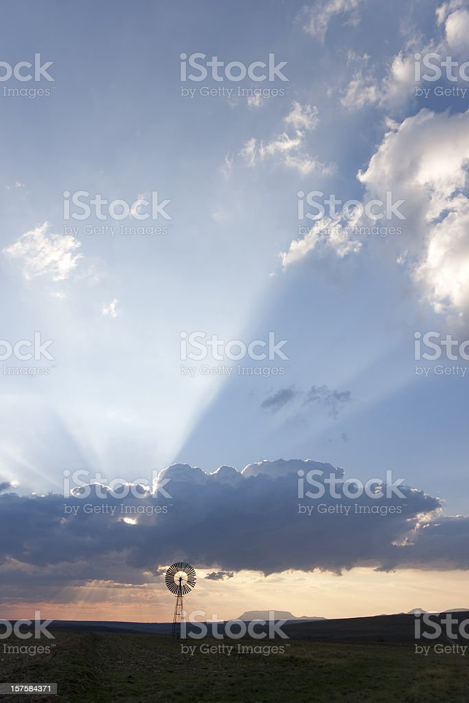 Clouds and windmill in the Free State South Africa stock photo
