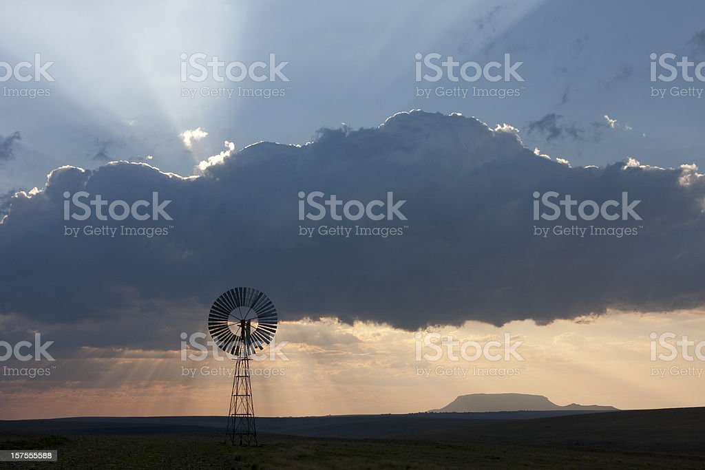 Clouds and windmill landscape in rural South Africa stock photo
