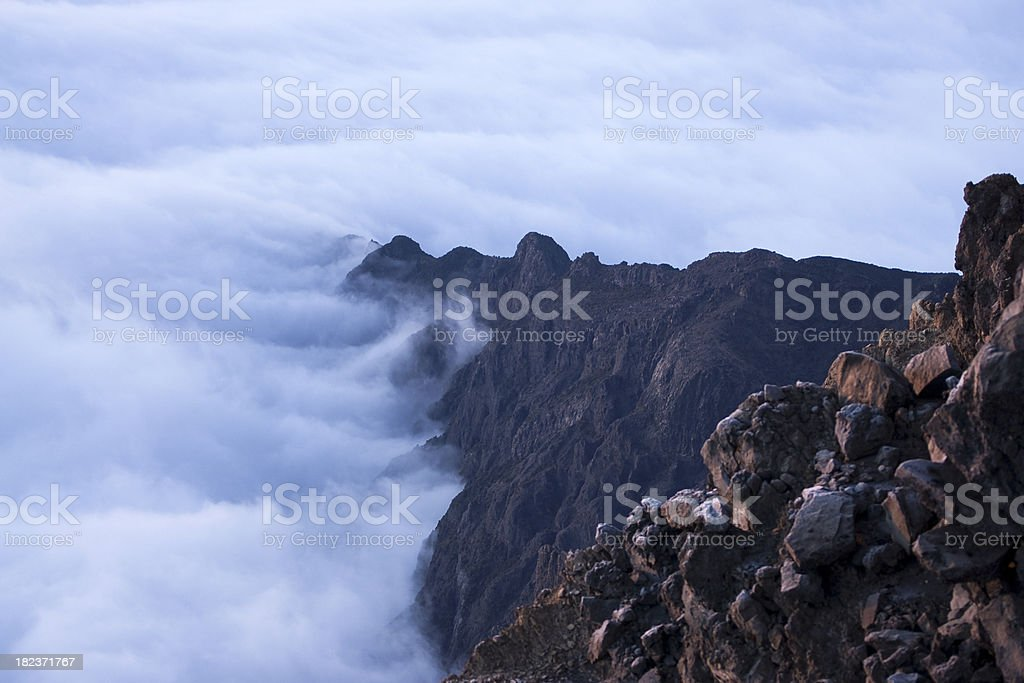 Clouds at foot of Mount Meru stock photo