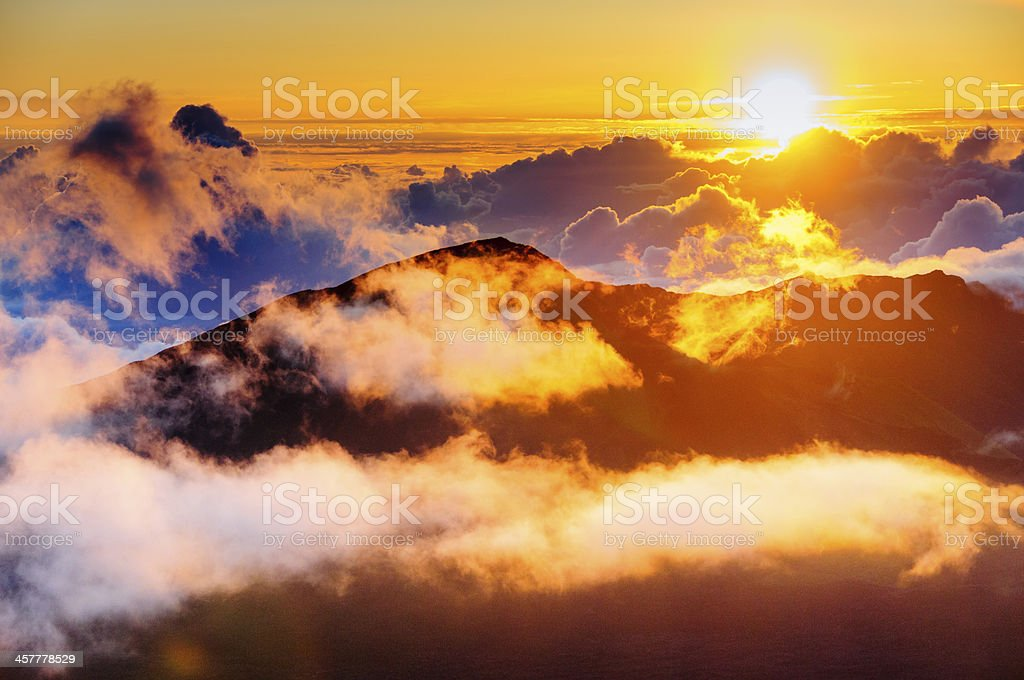 Clouds at sunrise over Haleakala Crater, Maui, Hawaii, USA stock photo