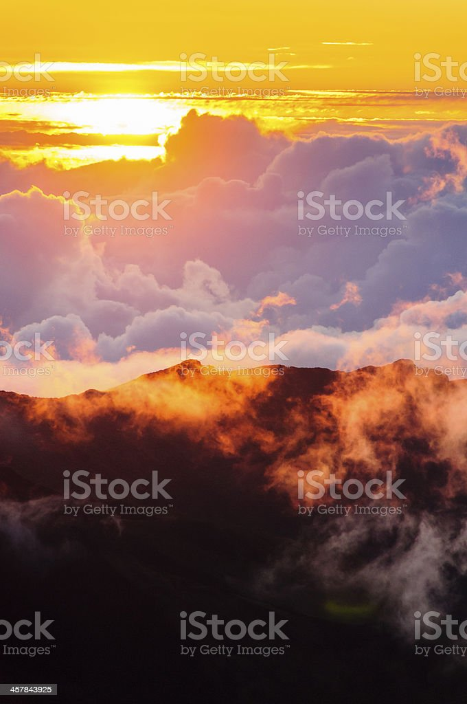 Clouds at sunrise over Haleakala Crater, Maui, Hawaii, USA stock photo