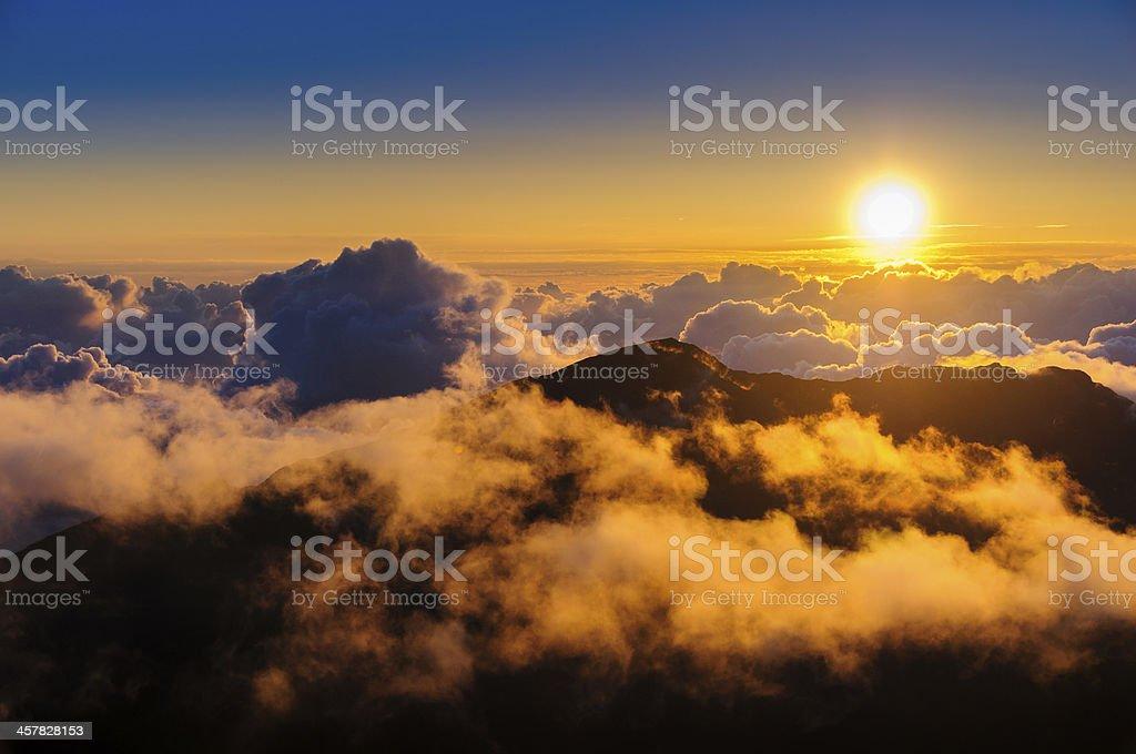 Clouds at sunrise over Haleakala Crater on Maui, Hawaii stock photo
