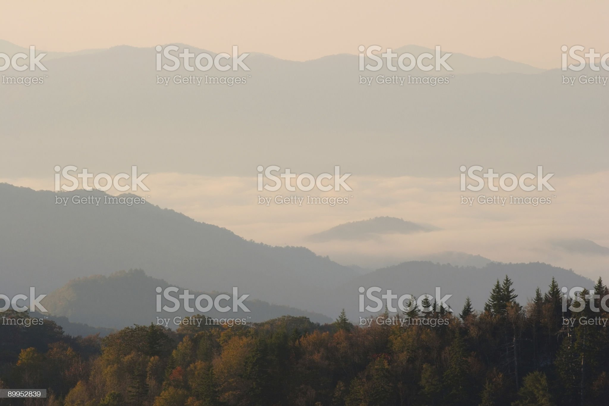 Clouds Between Autumn Mountain Peaks royalty-free stock photo