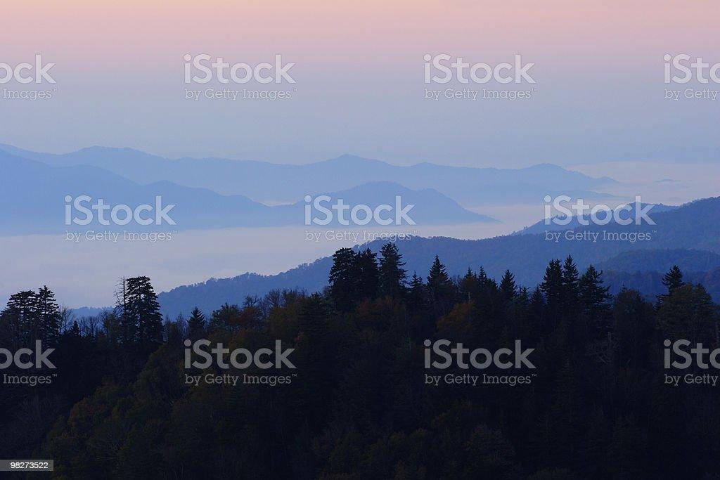 Clouds Between Sunrise Peaks stock photo