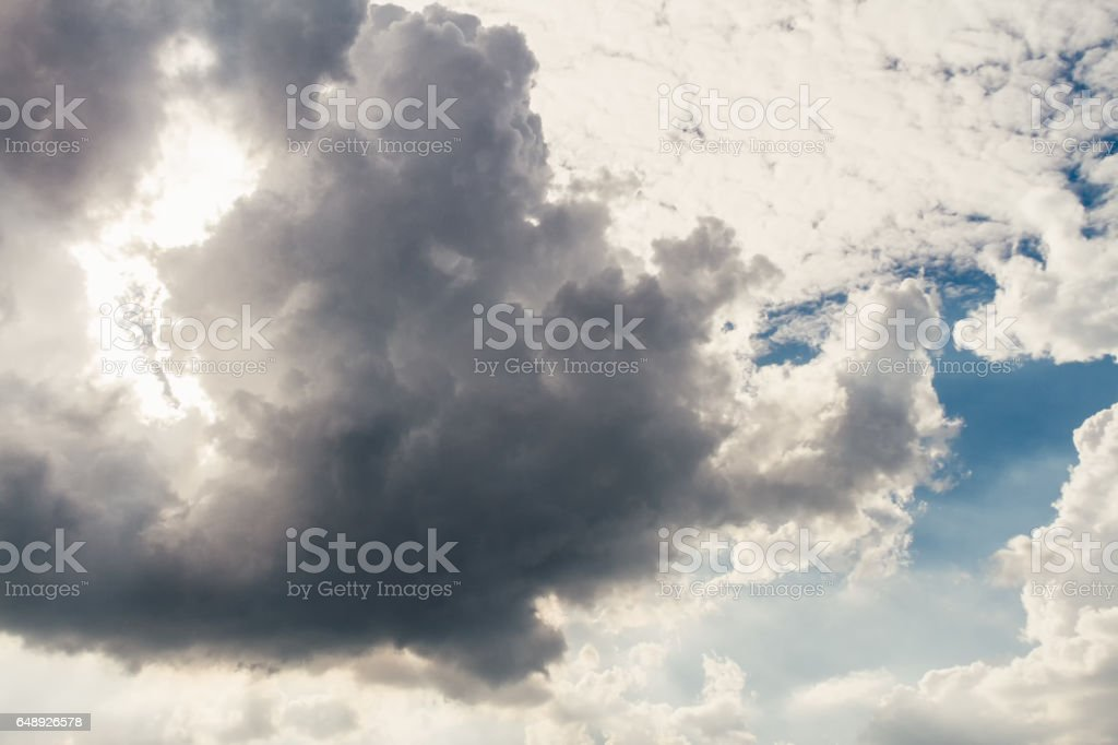 Clouds cirrus and cumulonimbus against blue sky at sunset stock photo