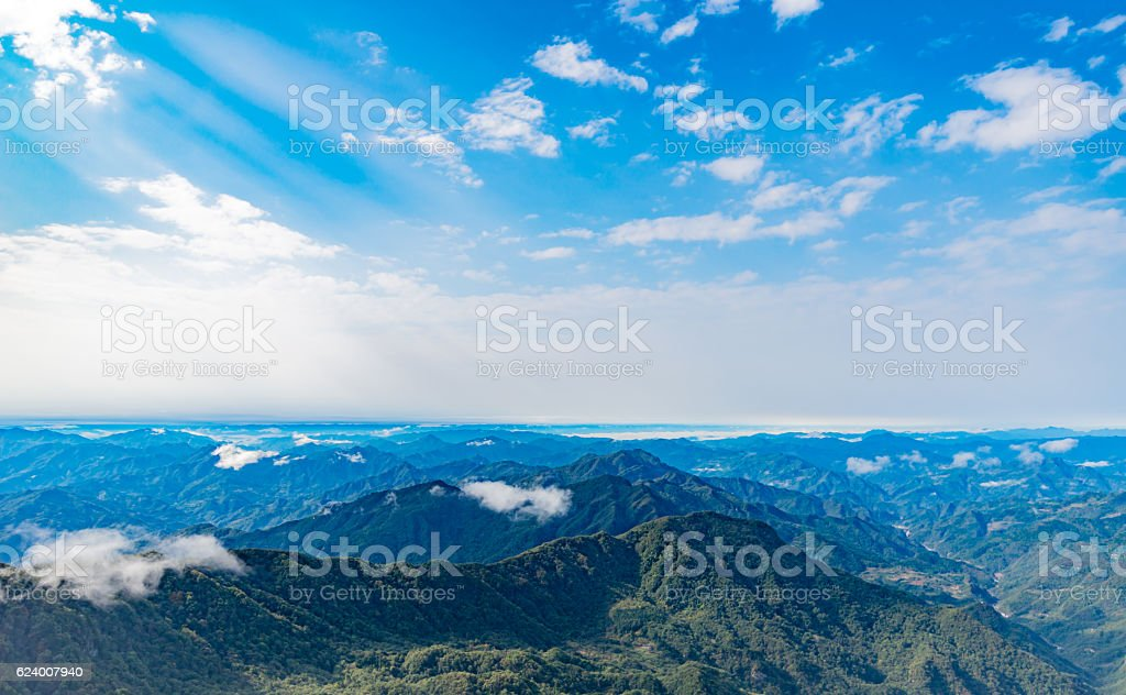 Clouds float over the mountains stock photo