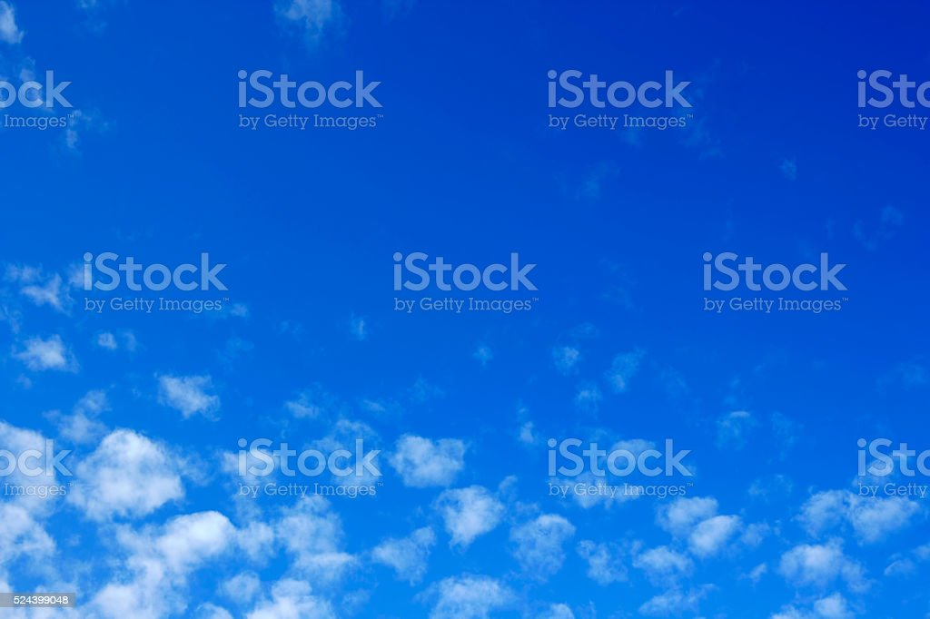 Clouds in a blue sky (with copyspace) stock photo