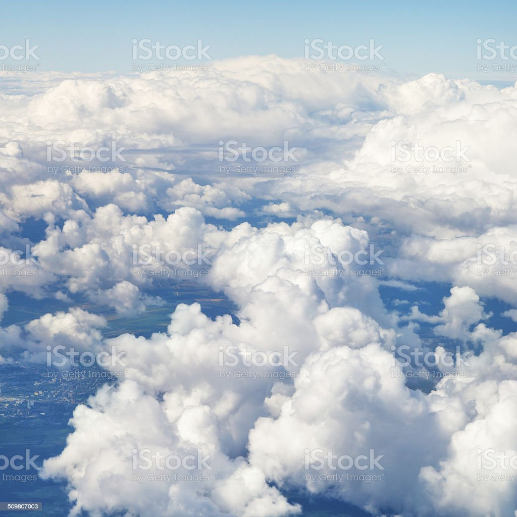 clouds in blue sky and earht under clouds stock photo