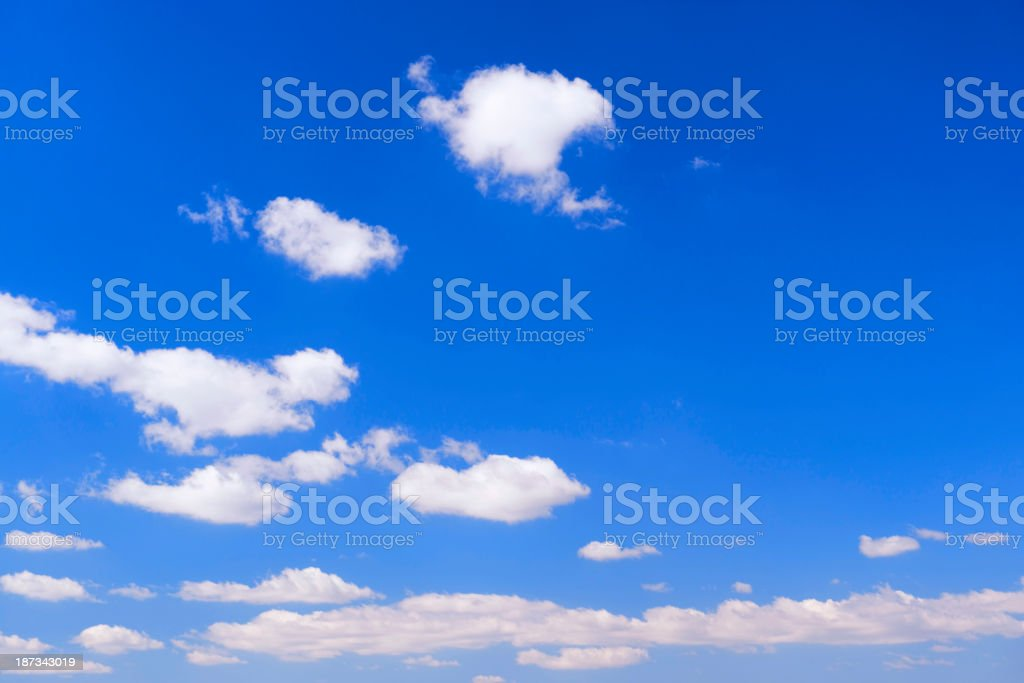 Clouds in clear blue sky royalty-free stock photo