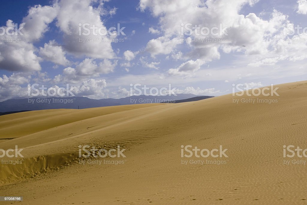 Clouds in desertic lands stock photo
