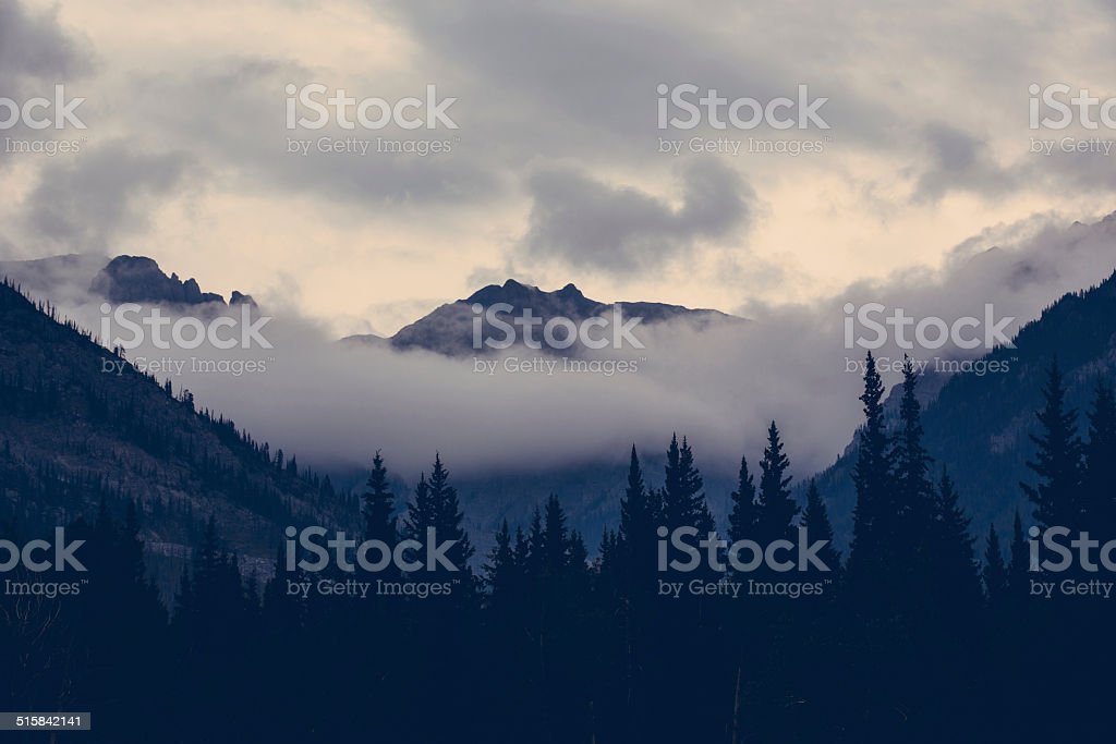 Clouds in the rockies stock photo