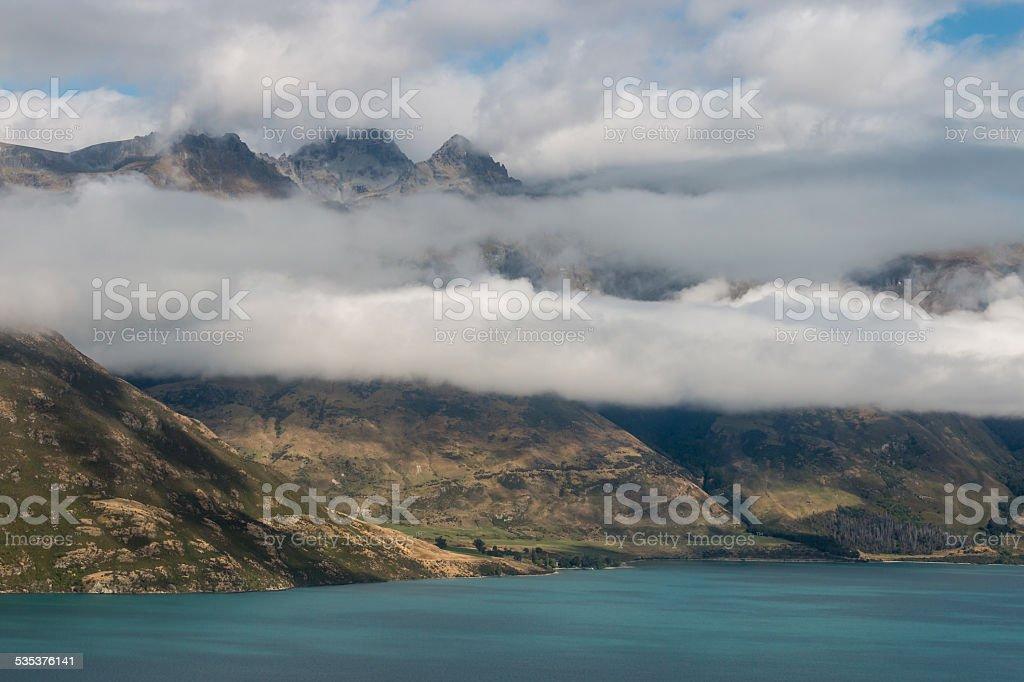 clouds inversion above lake Wakatipu stock photo