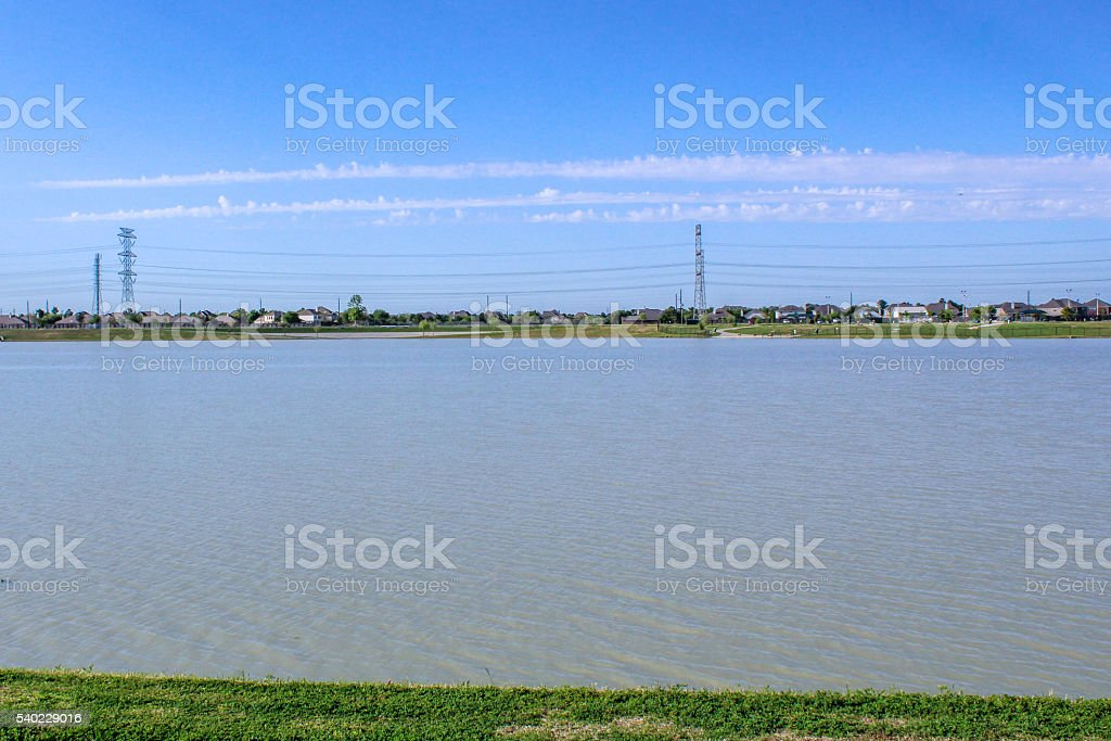 Clouds mirroring power lines stock photo