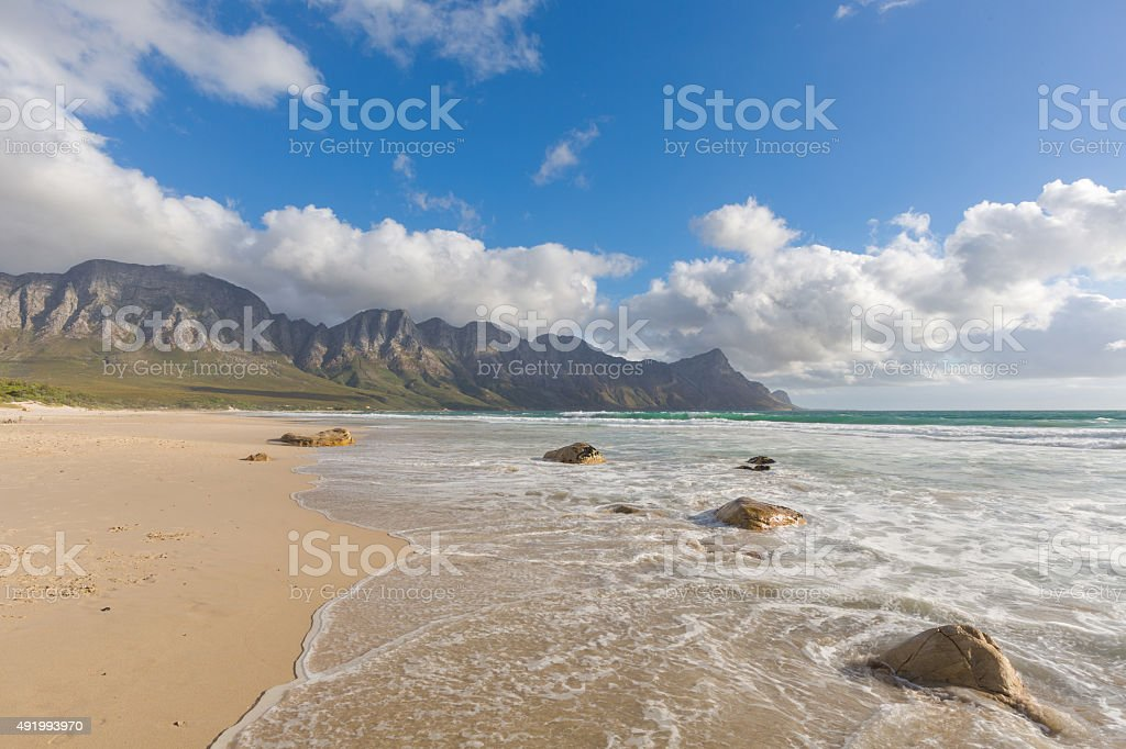 Clouds, mountain and sea stock photo