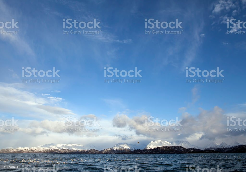 Clouds, mountains and the sea stock photo