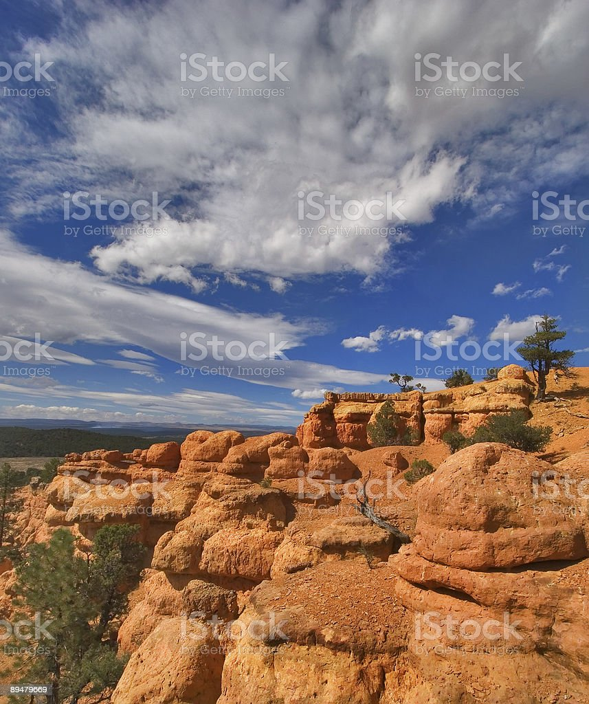 Clouds on a red canyon royalty-free stock photo