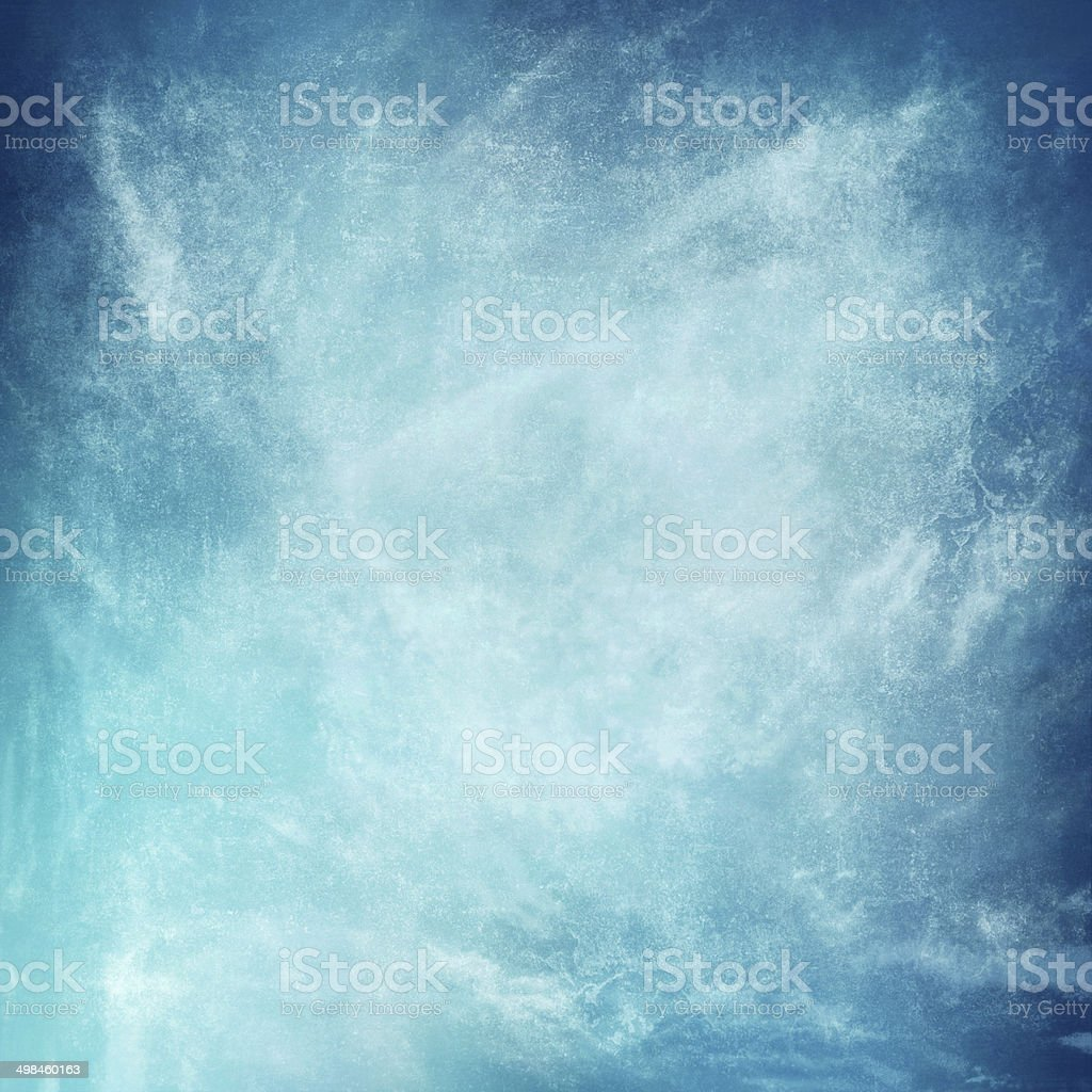 clouds on a textured vintage paper background, with grunge stains stock photo