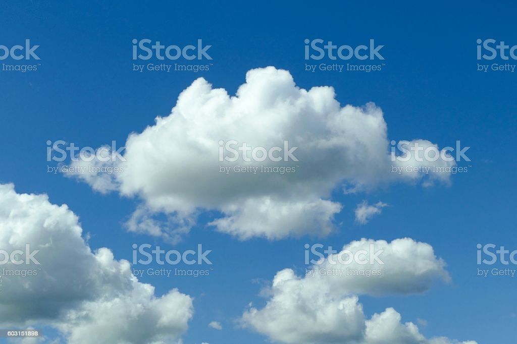 Clouds on clear blue sky background stock photo