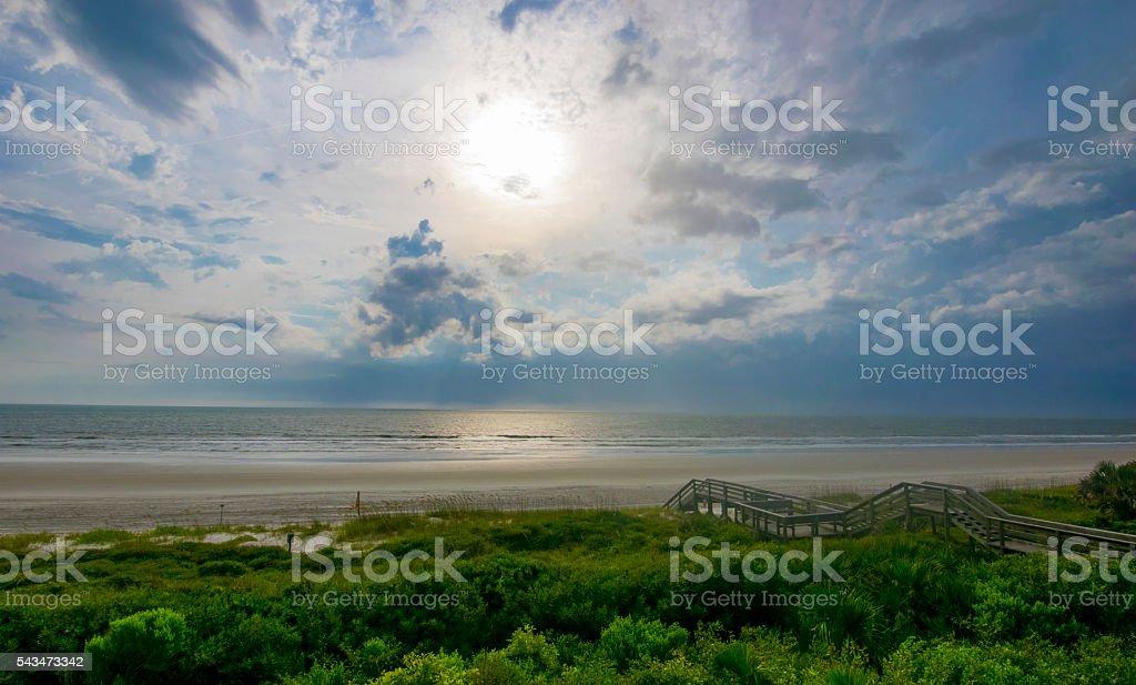 Clouds on Lush Beach stock photo