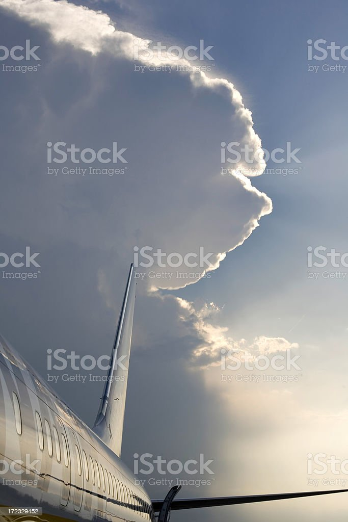 Clouds over a plane royalty-free stock photo