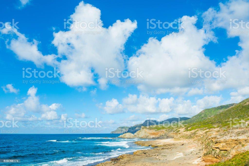 Clouds over Argentiera coastline stock photo