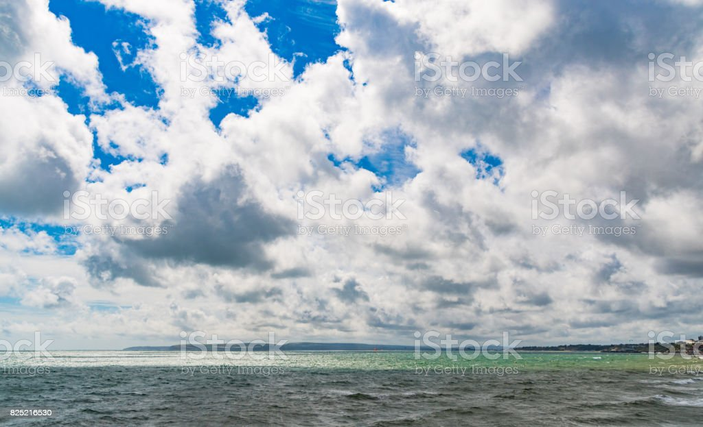 Clouds over Bournemouth  beach and Purbeck Hills stock photo