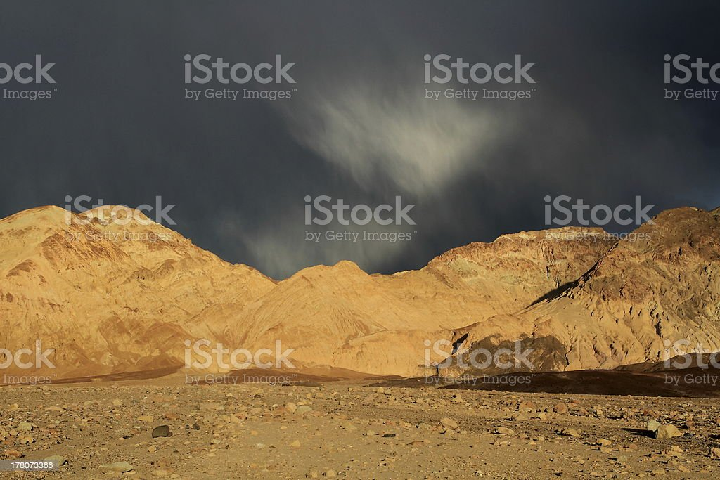 Clouds over desert stock photo