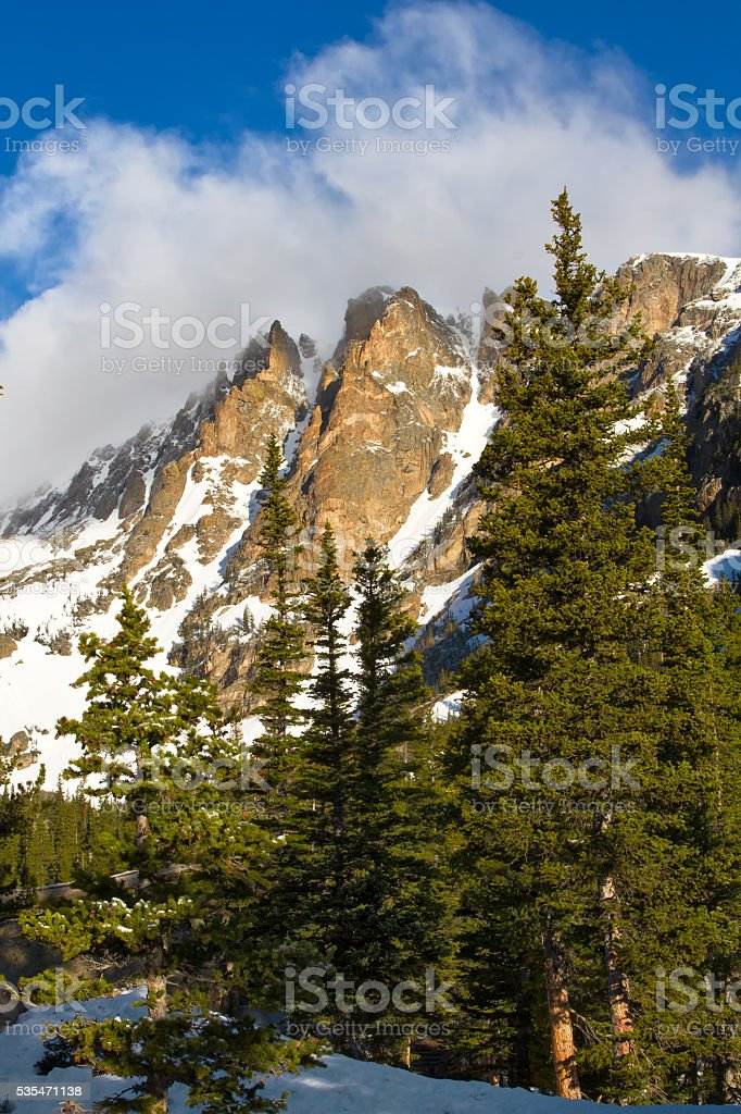 Clouds over Flattop Peak in Rocky Mountain National Park stock photo