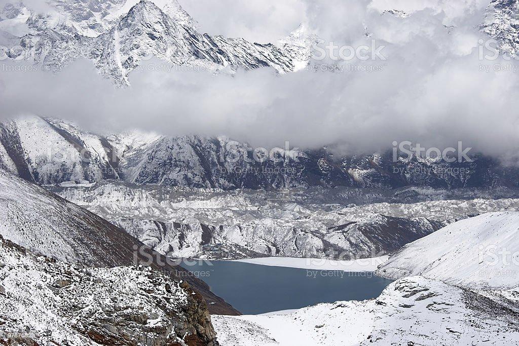Clouds over glacier and mountain lake, Himalaya royalty-free stock photo