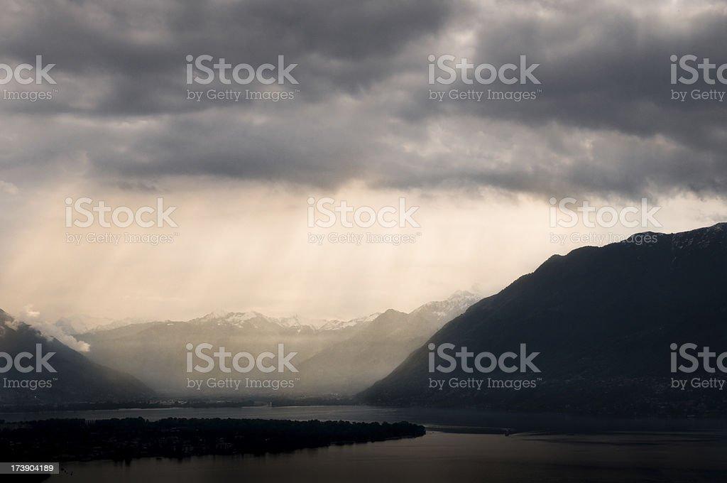 clouds over lago maggiore switzerland royalty-free stock photo
