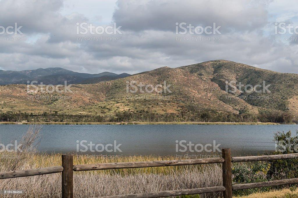 Clouds over Mountain Range and Lake in Chula Vista, California stock photo