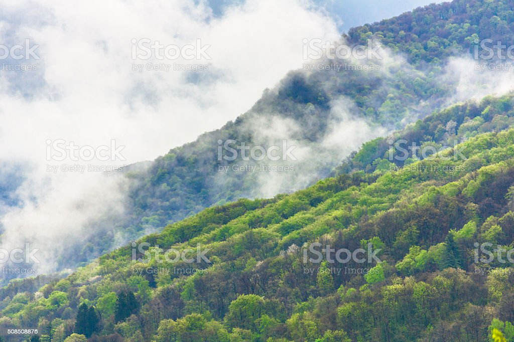 Clouds over Mountains in Lugano stock photo