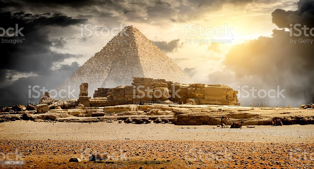 Clouds over pyramid stock photo