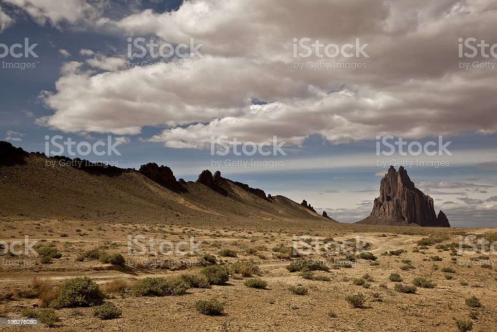 Clouds over shiprock on the Navajo Nation in New Mexico stock photo