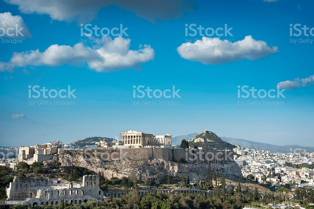 Clouds over the Acropolis with Minimal City stock photo