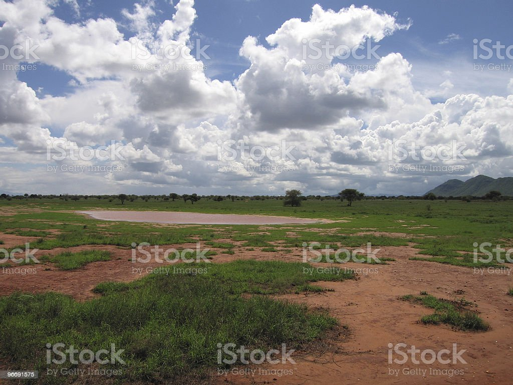 Clouds over the red dust of Tanzania stock photo