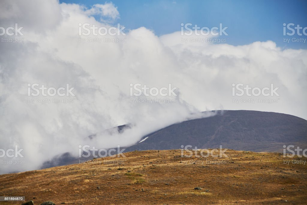 Clouds over the steppe open spaces, storm clouds over the hills. The Ukok Plateau In The Altai. Fabulous cold landscapes. Anyone around stock photo