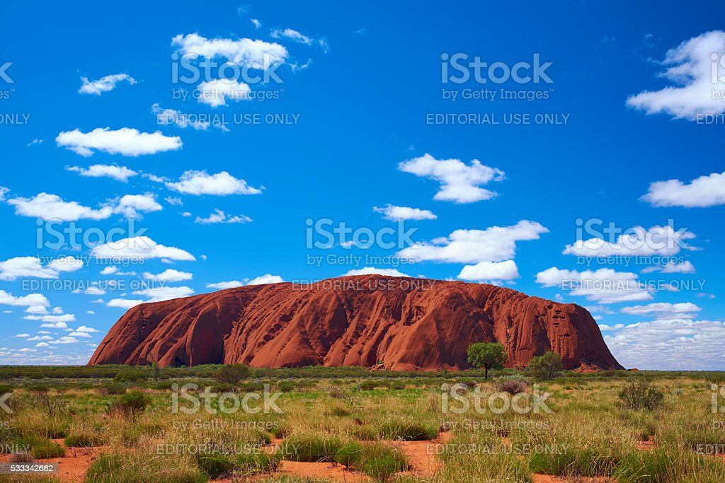 Clouds Over Uluru stock photo