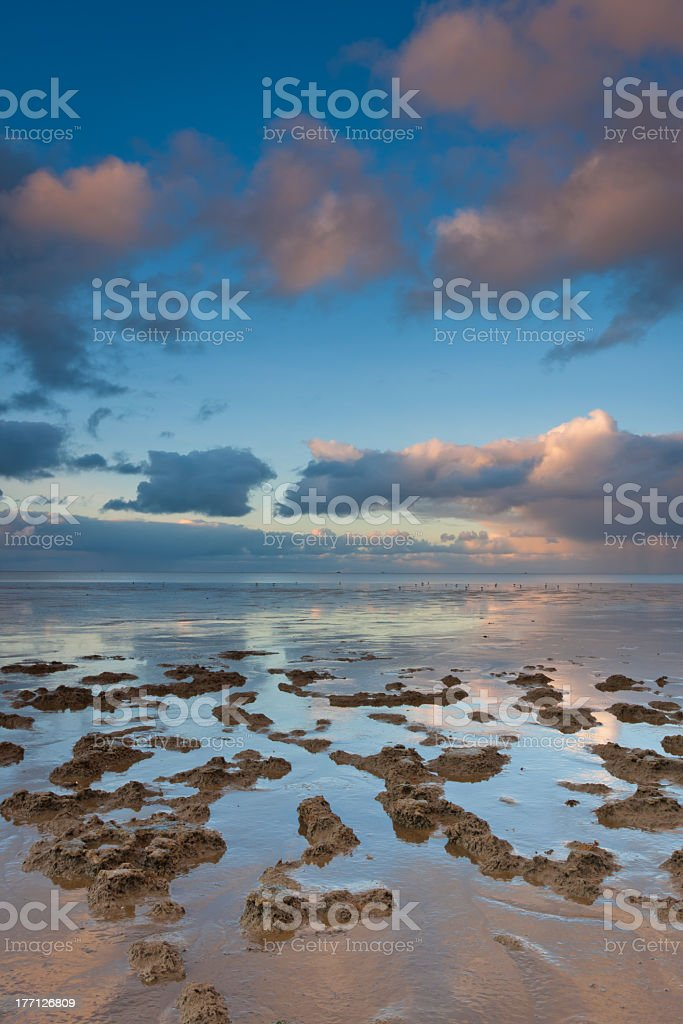 Clouds over Waddensea stock photo