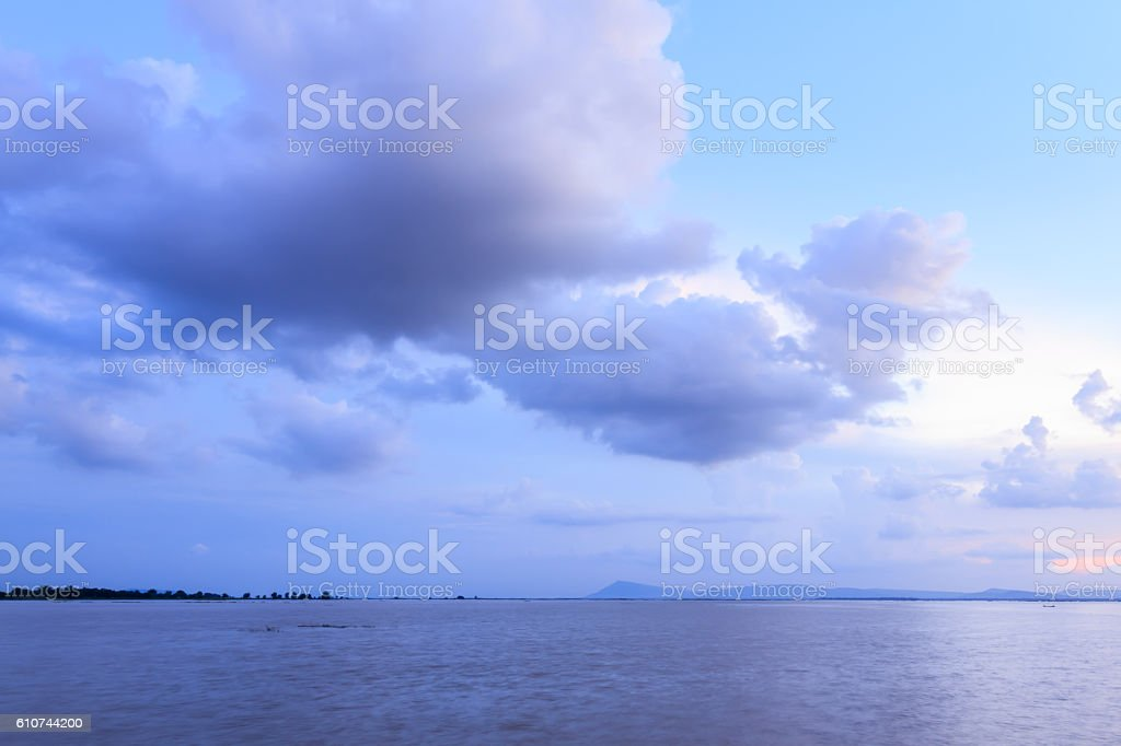 Clouds over water stock photo