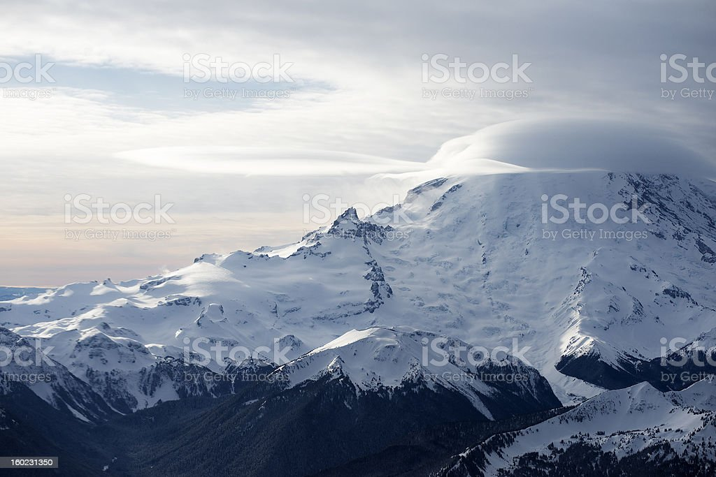 clouds passing Mountain Rainier stock photo
