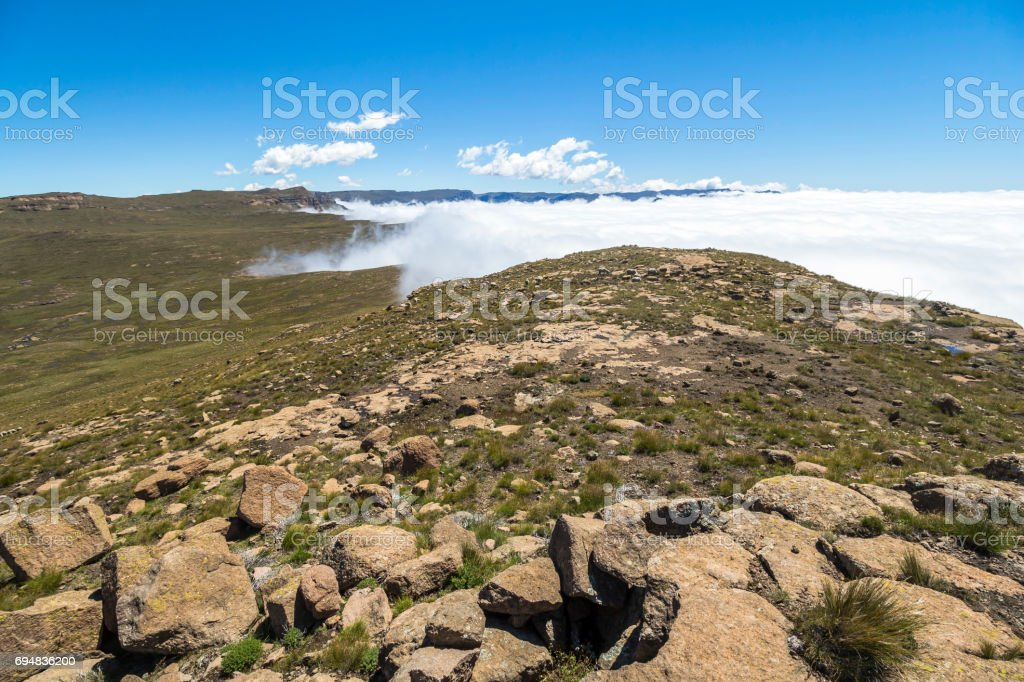 Clouds reaching the plateau of Drakensberge at Sentinel Hike stock photo