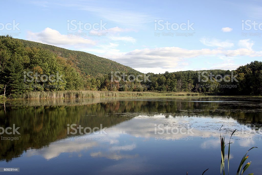 Clouds refelected in a mountain lake stock photo