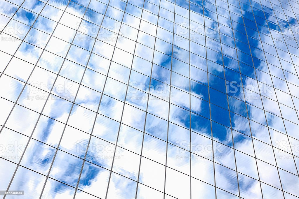 Clouds reflected in a modern glass facade stock photo