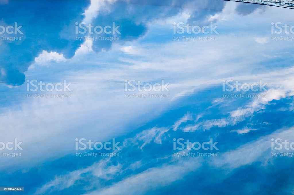 Clouds reflected in a swimming pool near the sea stock photo