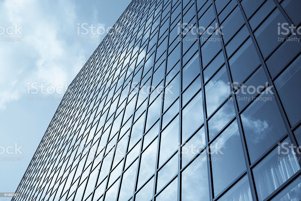 Clouds reflected in glass office building facade royalty-free stock photo