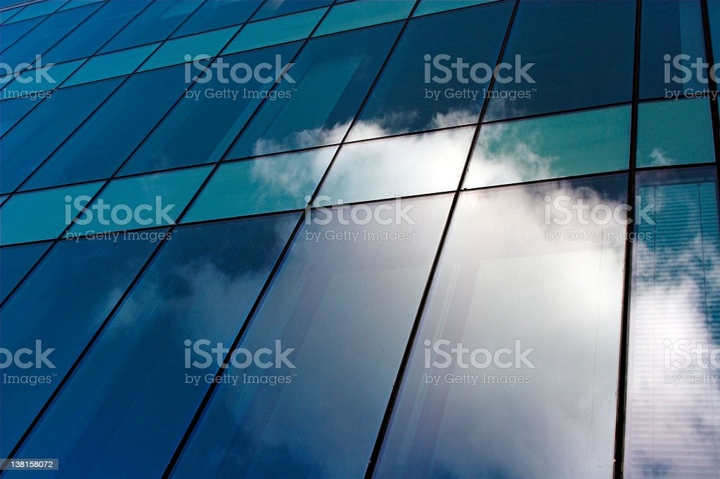 clouds reflected in modern glass office building royalty-free stock photo