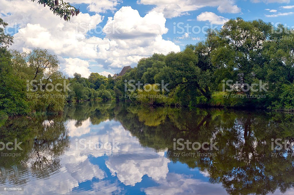 Clouds reflecting in Bobr River, Bobr Valley Landscape Park, Pol stock photo