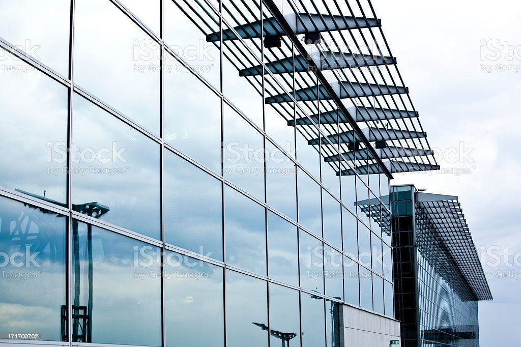 Clouds reflecting on a modern glass facade royalty-free stock photo